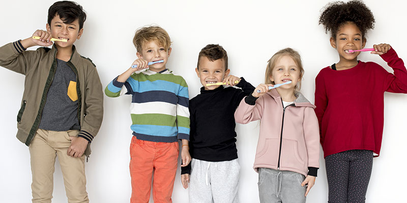 group-of-young-children-brushing-their-teeth